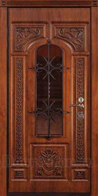 Металлическая дверь с ковкой красно-коричневая