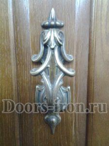 Элемент ковки на дверь