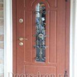 Металлическая дверь мдф с кованными элементами