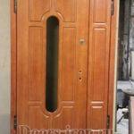 Полуторная входная дверь с овальным стеклом