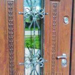 металлическая входная дверь с ковкой