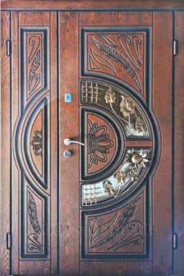 Двухстворчатая железная входная дверь с ковкой